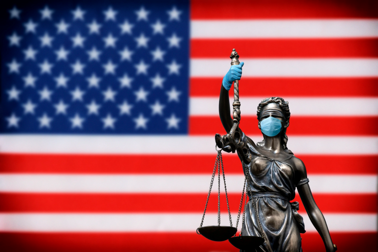 Justice with mask and gloves in front of the american flag