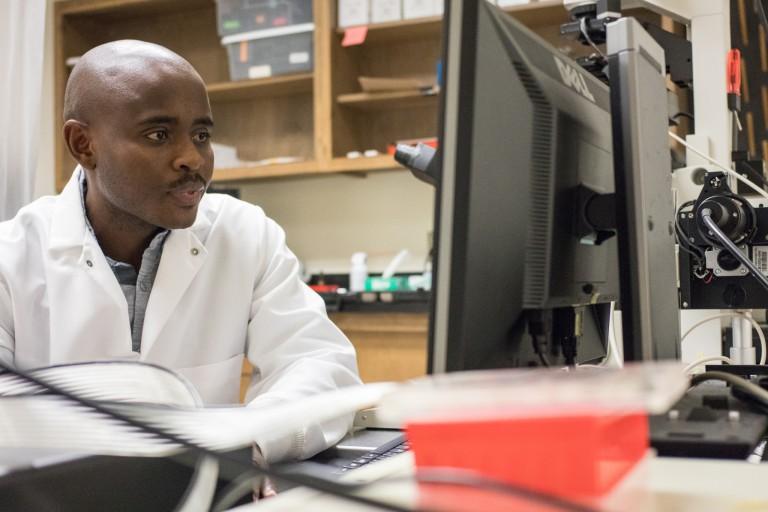 Gabriel Muhire Gihana working in the lab.