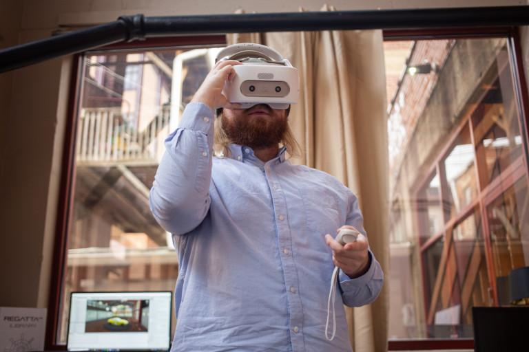 A RegattaVR employee enters a virtual environment.