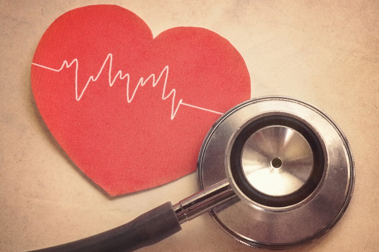 Paper heart with a stethoscope