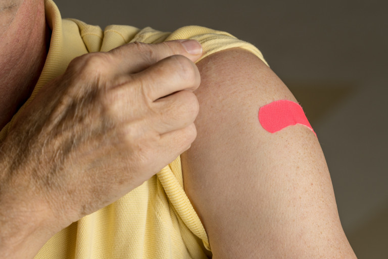 A person's arm with a bandaid on it