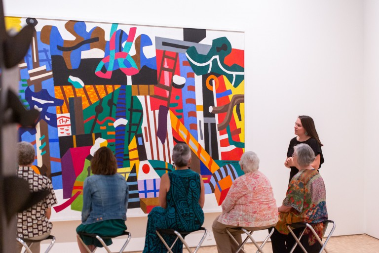 Lauren Daugherty interacts with visitors at the Eskenazi Museum of Art