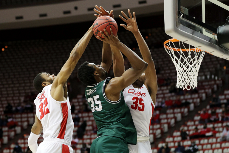 Houston players defend a shot by a Cleveland State player