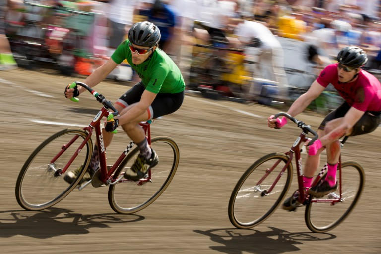 Riders competing the 2016 Little 500 bike race round a corner of the track.