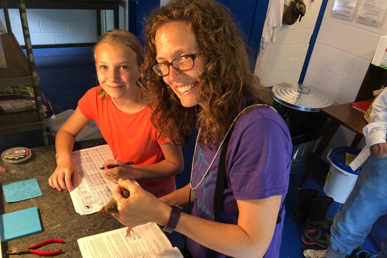 Eve Cusack and daughter at IU's Kent Farm Banding Station