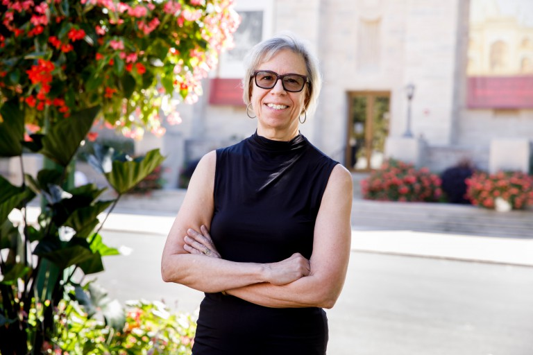 Darlene Sadlier in front of Lilly Library