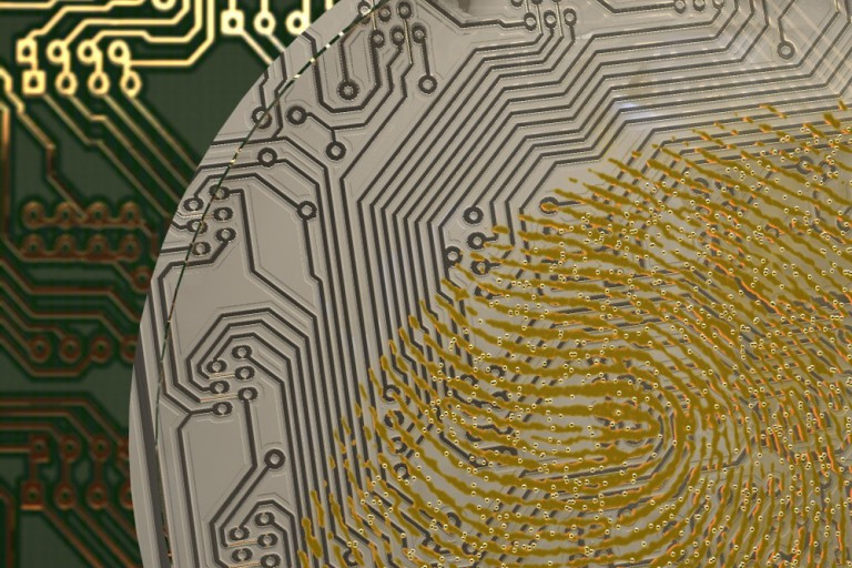 graphic of a gold fingerprint on top of circuit board