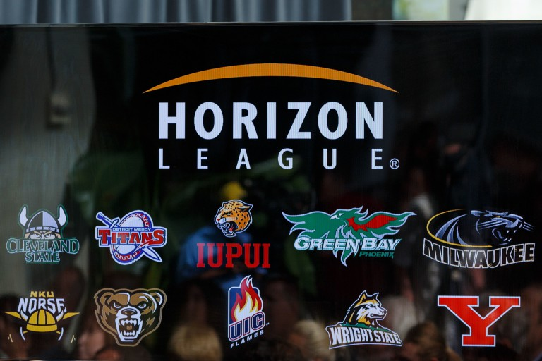 A screen shows logos of Horizon League schools.