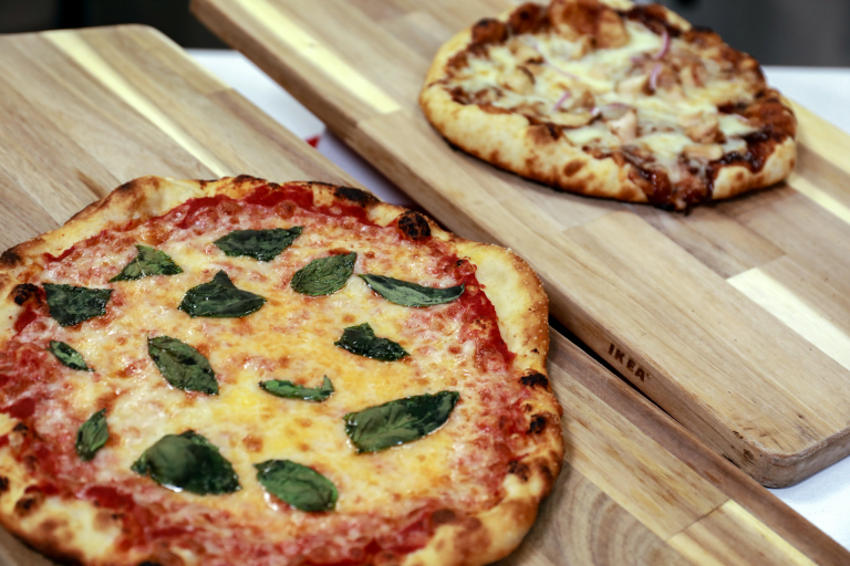pizzas on wooden cutting boards
