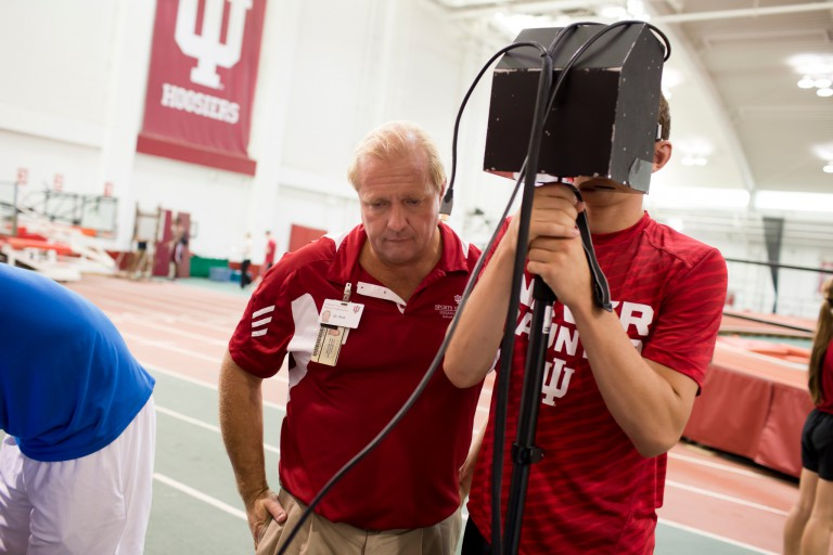 Nicholas Port tests an athlete for signs of concussion using eye-tracking technology
