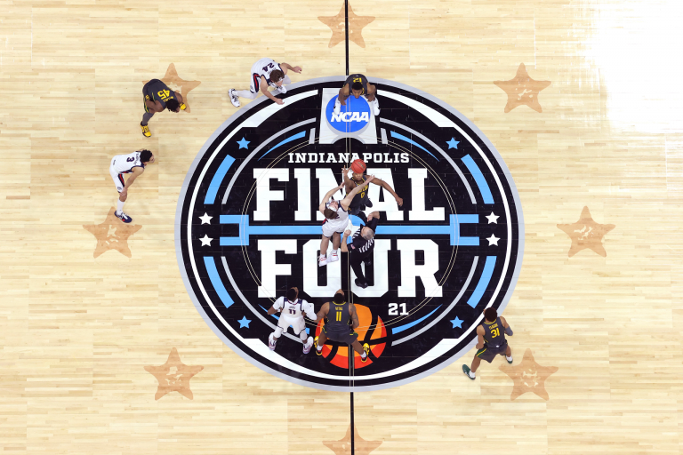 An overhead view of tip-off from a NCAA tournament game