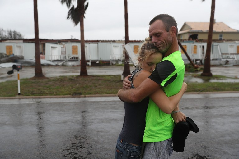 A man and woman embraces after riding out Hurricane Harvey in Rockport, Texas.