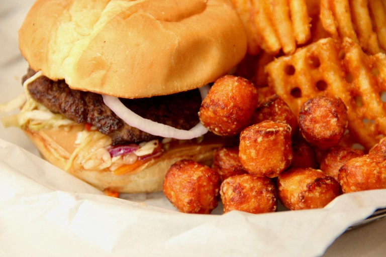 Burger, sweet potato tots and waffle fries from Punch Burger