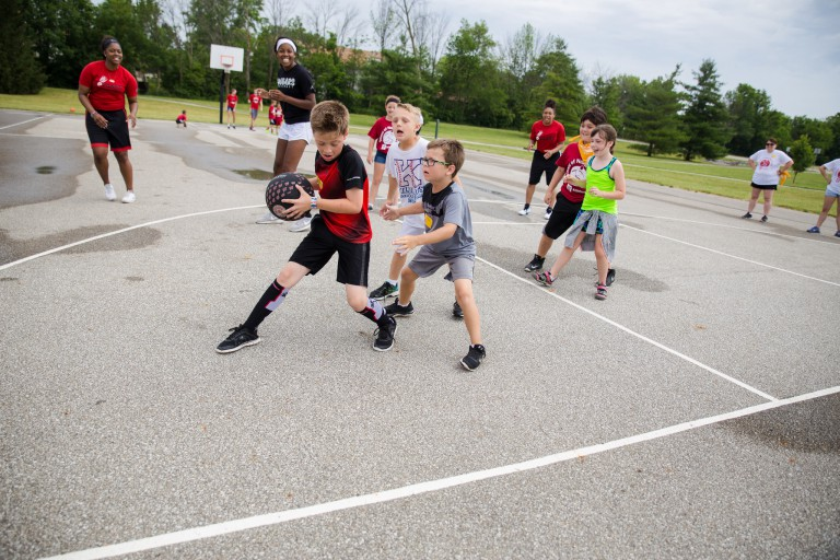 Kids play basketball at Fit Camp