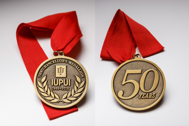 Front and back views of the 50th Anniversary Chancellor's Medallion