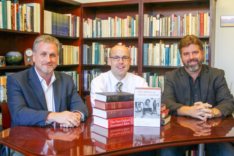 Three co-editors of 'The Bible in American Life' and their book