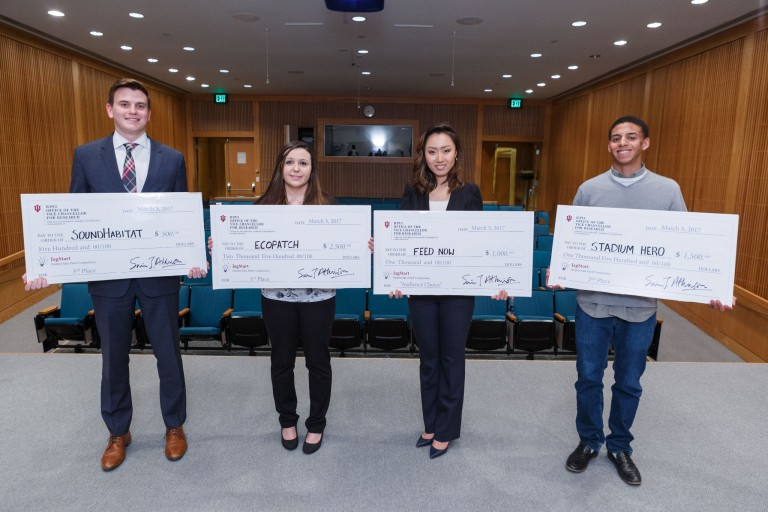 The winners of the 2017 JagStart student entrepreneur competition hold their giant checks