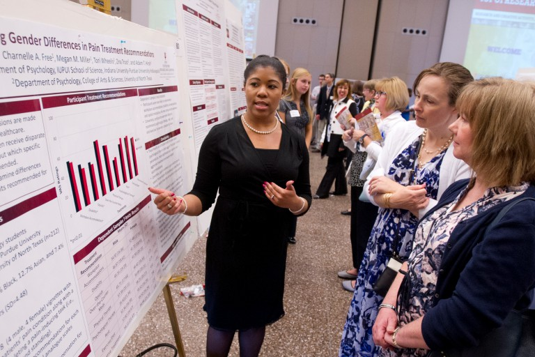 A student discusses her research.