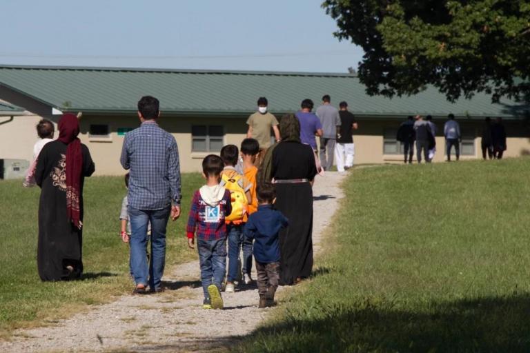 Afghan refugees walking at Camp Atterbury