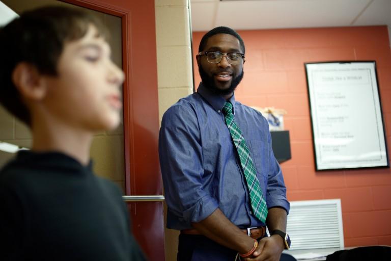 Brian Richardson Jr. listens as a student recites the Krimson Leadership Academy mantra.