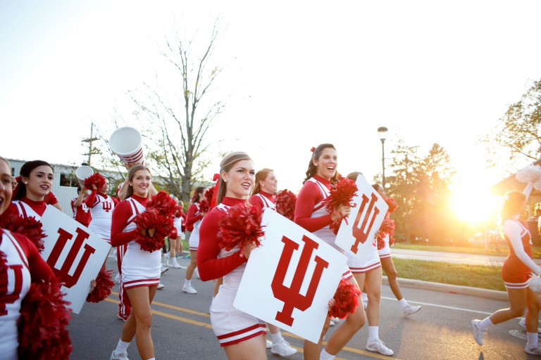 Cheerleaders march in the homecoming parade.
