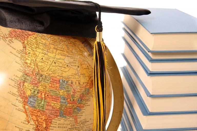 A graduation cap on a globe.
