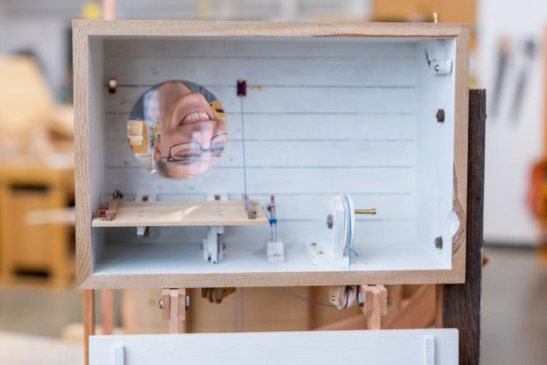 """Herron's Katie Hudnall looks through """"The Seeing Machine."""""""