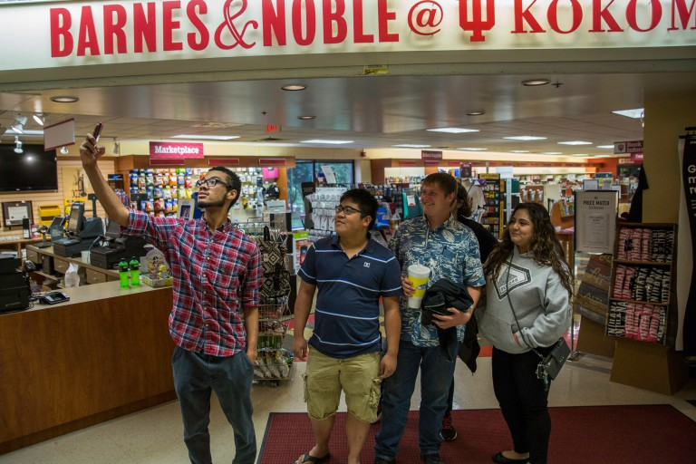 Students participating in the IU Kokomo Bridge program stop to take a selfie at the Barnes and Noble
