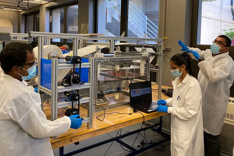 The Multiscale Integrated Technology Solutions team works in the lab.