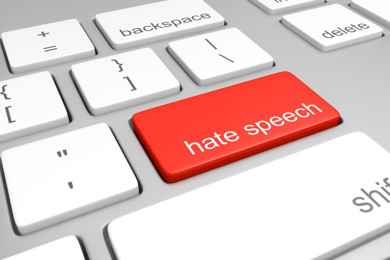 "Keyboard with key labeled ""hate speech"""