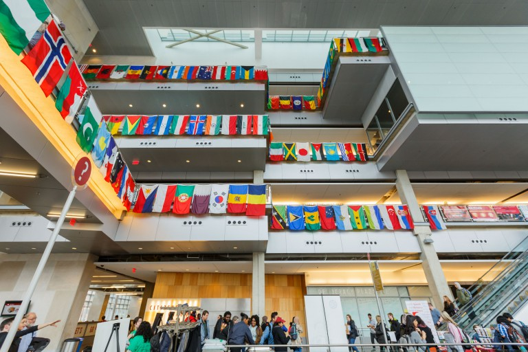 International flags hang in the IUPUI campus center
