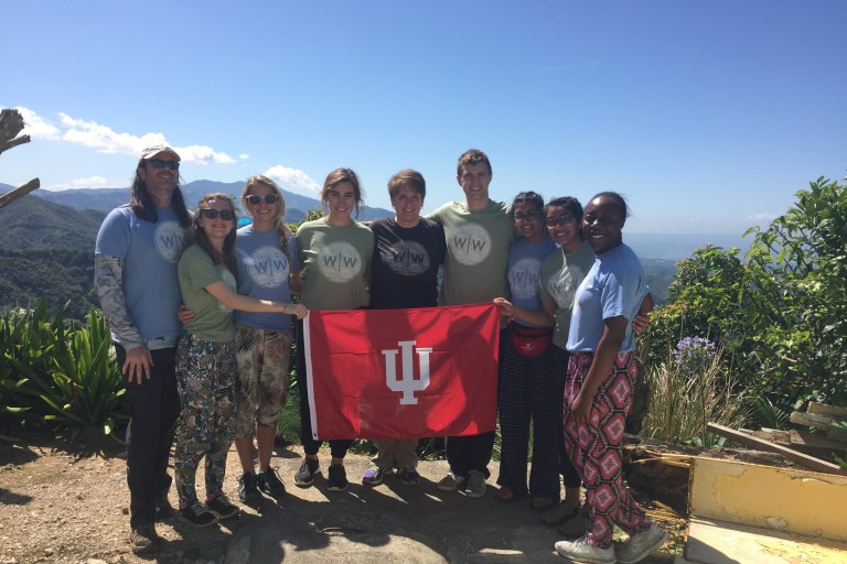 Students with the Timmy Water Project pose with an IU flag during a recent trip.