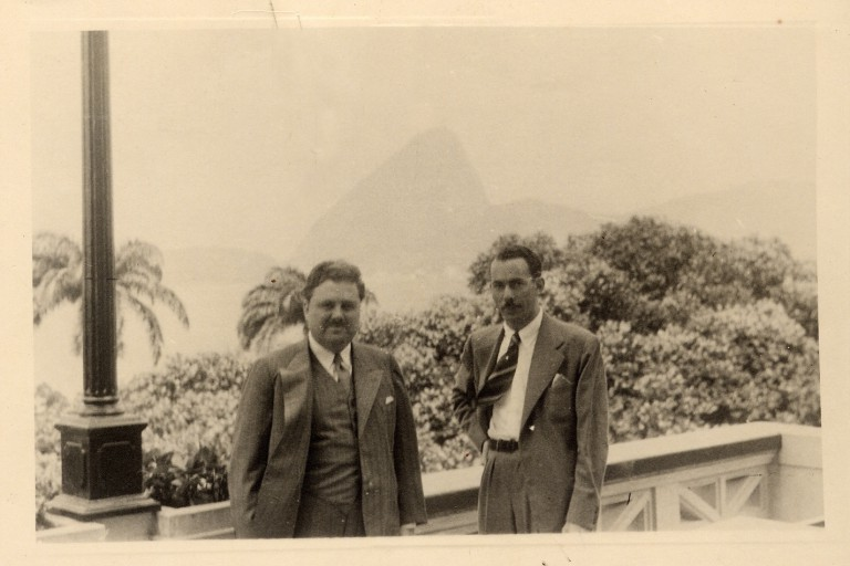 Herman B Wells standing with man in South America