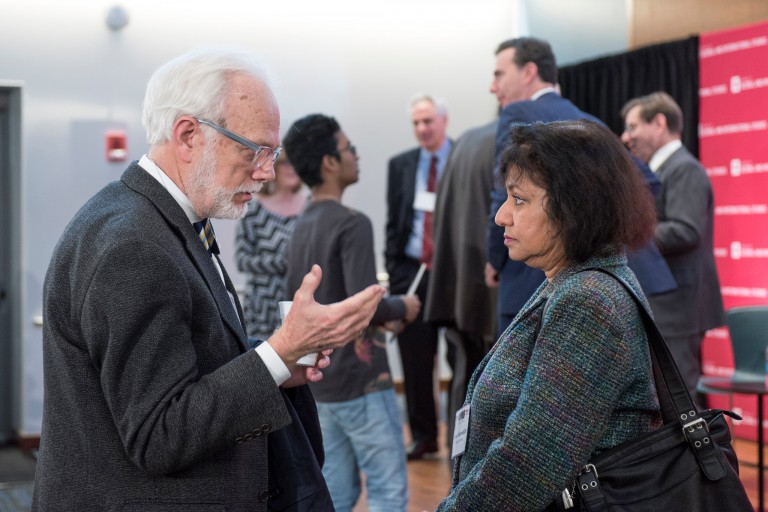 IU professor Asma Afsaruddin, right, discusses a point with a conference attendee