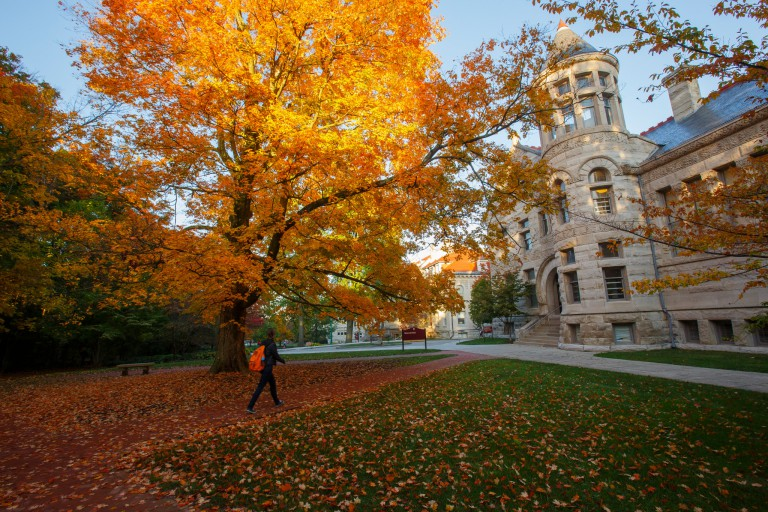 A student walks through IU's Old Crescent during fall