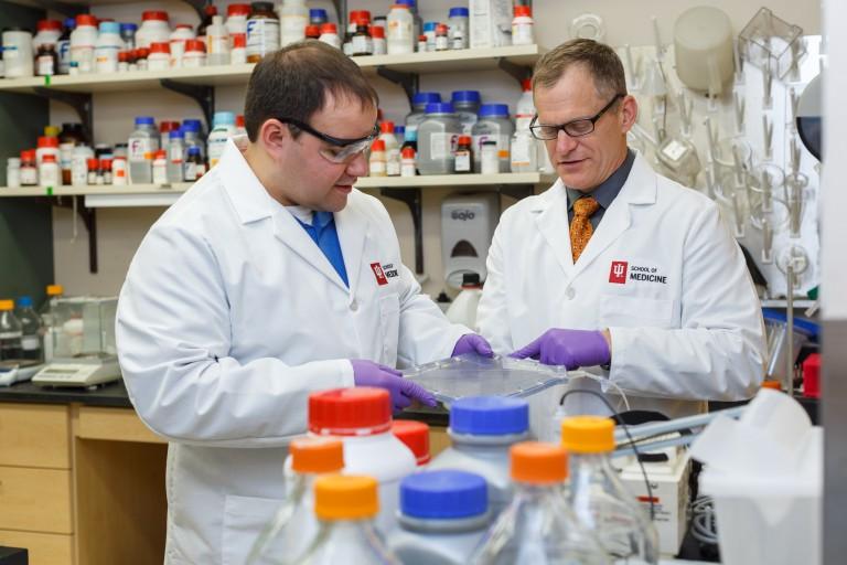 Dr. Jeffrey Kline, right, with Nathan Alves in Kline's lab.