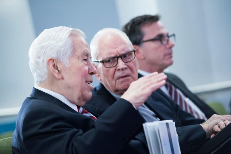 Richard Lugar explains a point to Lee Hamilton while Lee Feinstein sits next to them