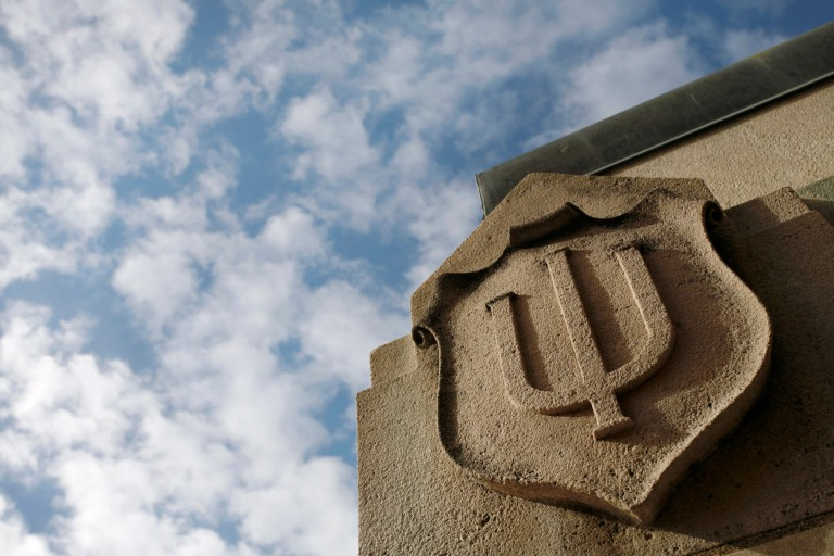 Limestone IU trident against a blue sky
