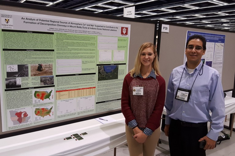 Katie Gurnicz and Cesar Garcia pose with their posters at the conference