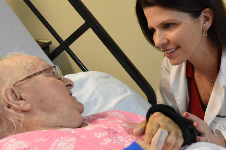 Dr. Kathleen Unroe of Care Revolution speaks with a nursing home patient