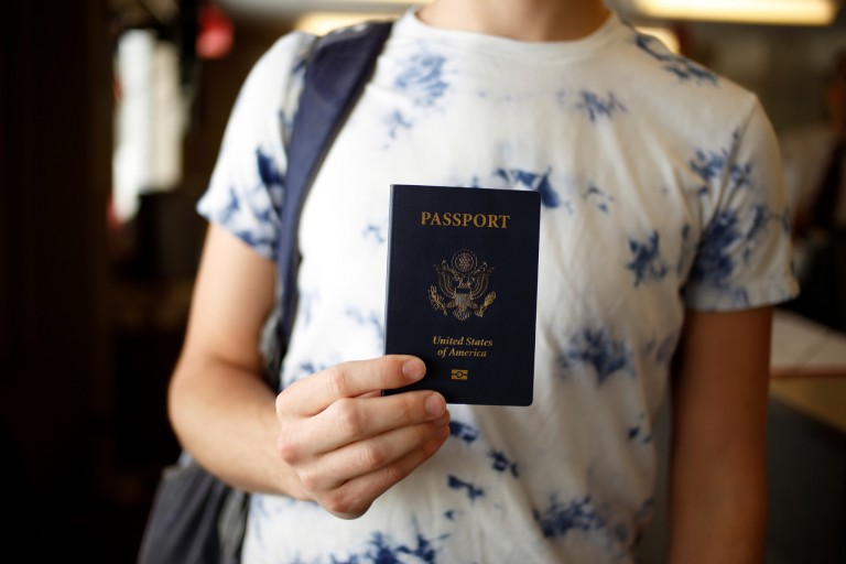 Student holding a passport