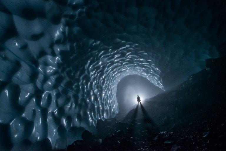 Person standing in Mount Rainier ice cave