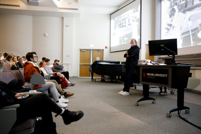 Dr. Glenn Gass speaks during his Z202 History of Rock Music II class.