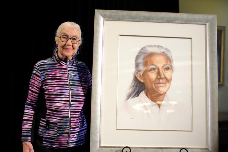 Harriett Inskeep stands next to her portrait