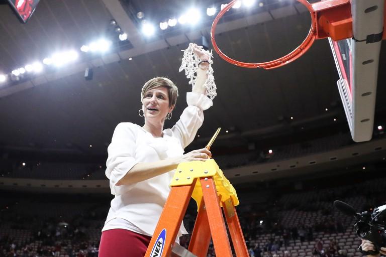 Teri Moren cutting the basketball net after winning the WNIT Championship.