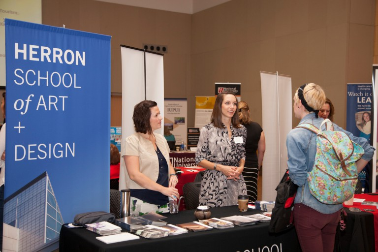 Students learn about graduate school from representatives who attend the IUPUI graduate expo.