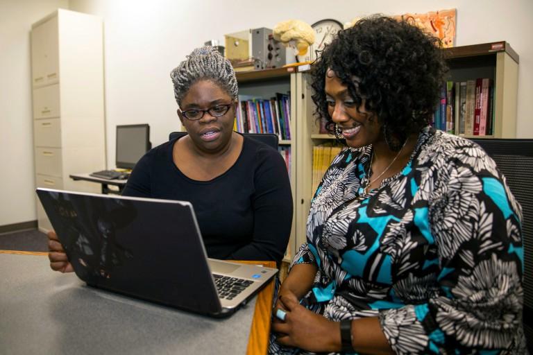 Rosalyn Davis and Shantel Galliard work at a computer