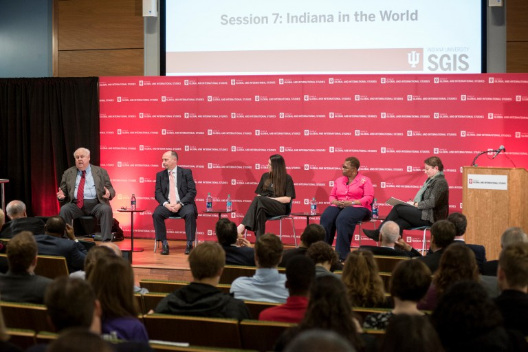 A panel of experts sits on stage during the recent America's Role in the World conference