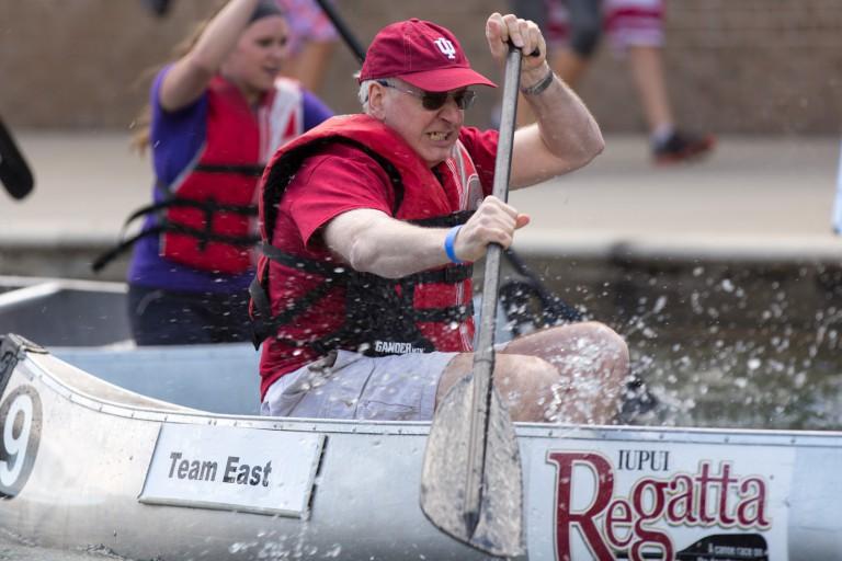 Man rows in a canoe.