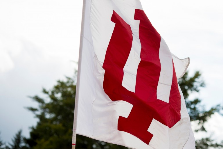 A red and white IU flag flies in the breeze.